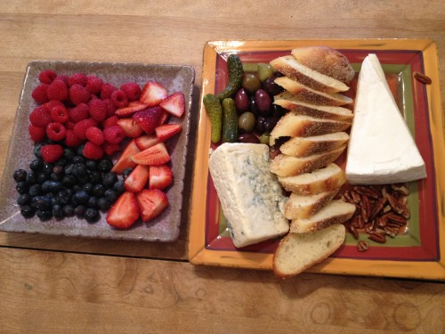 cheese board, fruit and cheese plate, brie cheese, bleu cheese, raspberries, blueberries, strawberries, pecans, olives, cornichons, gherkin